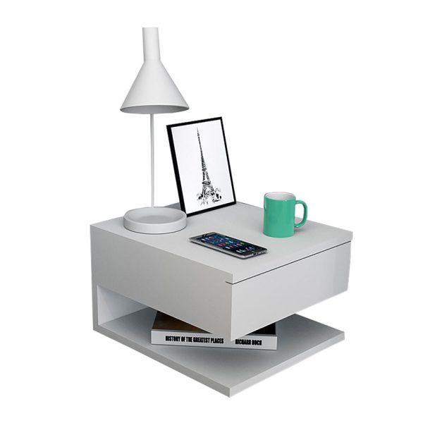 La mesa de noche flotante London se fija a la pared optimizando el espacio, ofrece un cajón y un compartimiento para elementos de uso diario